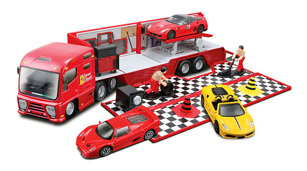 Ferrari Race and Play Hauler Set This hauler comes with:<br>- 1 car in 1/43 scale<br>- 6 accessories<br>- Racing trailer with opening tailgate ramp and side panel (1:43)