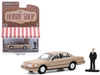 "1992 Ford Crown Victoria LX Gold Metallic with Man in Suit Figurine ""The Hobby Shop"" Series 9 1/64"